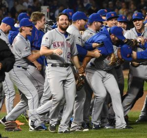 The NY Mets celebrate after sweeping the Cubs on October 20.